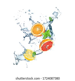 Falling fresh citrus fruits, ice cubes, mint and splashing water on white background