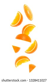 falling fresh orange fruit slices isolated on white background closeup. Flying food concept.