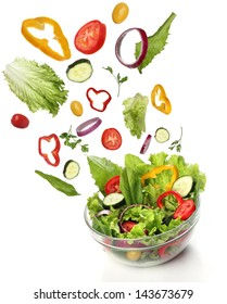 Falling fresh vegetables. Healthy salad isolated