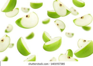 Falling green juicy apple isolated on white background, selective focus