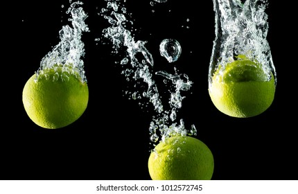 Falling limes with bubbles in the water.