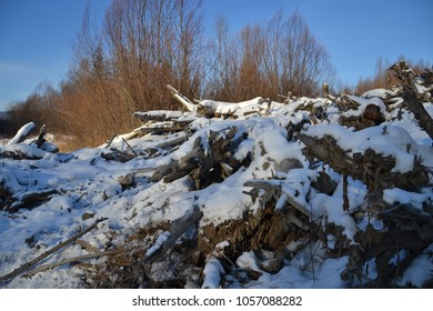Falling logs on the river in winter
