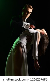 Falling in love. Mime man and woman act in romantic scene. Couple in love with mime makeup. Theatre actors miming through body motions. Couple of mime artists perform romance on stage.