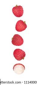 Falling lychee fruits isolated on white background