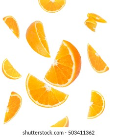 Falling orange and orange slices. Isolated on a white background. - Shutterstock ID 503411362