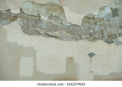 Falling plaster. Corrosion. The wall is water-soaked. Attempt to repair. Dilapidation. Painting.