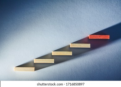 Falling and reduction. Growing and increasing. Business rise or fall. Wooden blocks in ascending order. Copy space