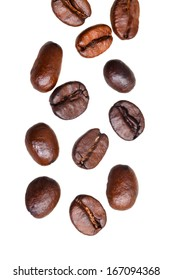 falling roasted coffee beans isolated on white background