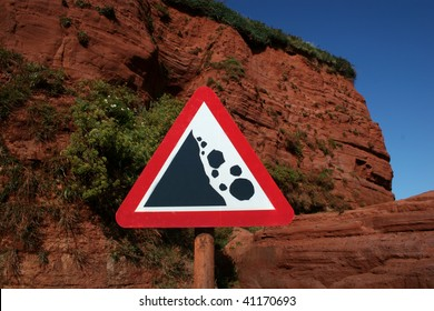 falling rock sign by cliff