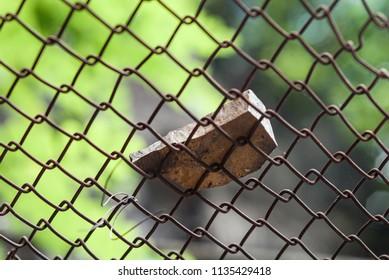 Falling rock stone rockfall slide protective fence barrier close-up macro