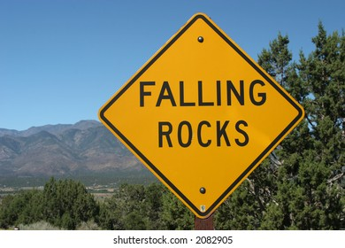 Falling rocks ahead road sign