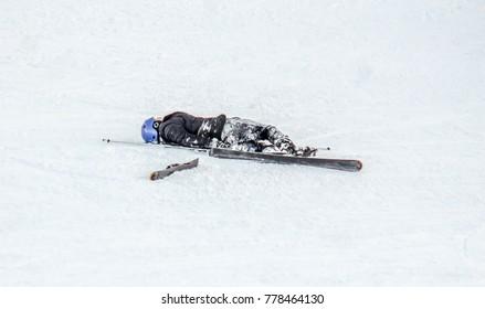 Falling skier on the mountainside at the ski resort