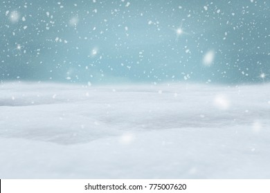 FALLING SNOW WITH SNOW ON THE GROUND FOR BACKGROUND