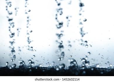 Falling and splashing water drops.