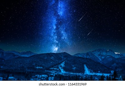 Falling stars and Giewont at night in winter, Tatra Mountains