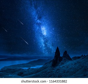 Falling stars over Old Man of Storr at night, Scotland