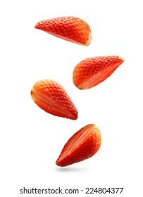 Falling strawberry isolated on white background