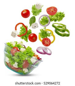 Falling vegetables in a salad bowl