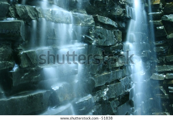 Falling water cascade and rocks