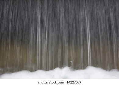 falling water with sprays and foam in blurred motion due to slow shutter speed
