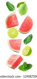 Falling watermelon with lime and mint isolated on white