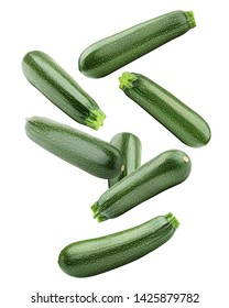 Falling zucchini isolated on white background, clipping path, full depth of field