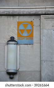Fallout Shelter sign with lamp on gray wall