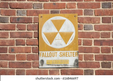 Fallout Shelter Sign on Brick Wall