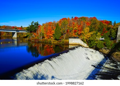 The Falls and Bridge in autumn with colorful trees and the blue sky.The Montmorency Falls Park(Parc de la Chute-Montmorency), Quebec, Canada, 2016.