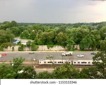 """Falls Church, Virginia, USA - August 8, 2018: A new """"7000 Series"""" Metro train travels parallel to Interstate 66 in Northern Virginia during the afternoon commute in this busy Fairfax County suburb."""