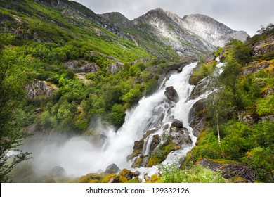 Falls in mountains of Norway in rainy weather.