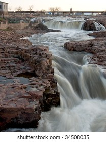 The falls on the Big Sioux River that give Sioux Falls, SD its name.  Viewed from the tower in Falls Park at sunset.