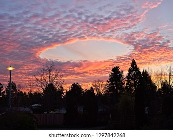 Fallstreak hole, sky phenomenon, also known as punch hole cloud, over Victoria, capital of British Columbia, Canada