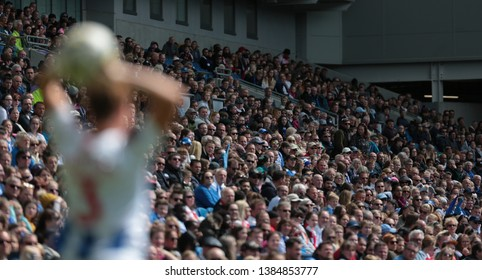 FALMER, BRIGHTON, EAST SUSSEX / UNITED KINGDOM - APRIL 28 2019: Crowd watches on during the match between Arsenal and Brighton and Hove Albion in the FAWSL match at American Express Community Stadium.