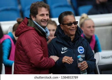 FALMER, BRIGHTON, EAST SUSSEX / UNITED KINGDOM - APRIL 28 2019: Joe Montemurro and Hope Powell at the match between Arsenal and Brighton and Hove Albion in the FA Women's Super League (FAWSL).