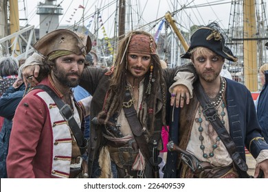 FALMOUTH, CORNWALL, UK - AUGUST 29, 2014 : Pirates including a Jack Sparrow look-a-like (from the Pirates of the Caribbean films) at Falmouth Tall Ships Regatta 2014.