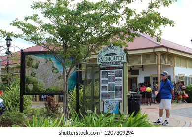 Falmouth, Jamaica: Dec. 4, 2017 –Male tourist examines large outdoor street map of Falmouth Jamaica with its historical markers and points of interest for tourists.