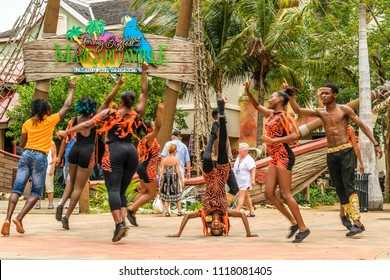 Falmouth, Jamaica - June 03 2015: Dancers performing at the entrance to Jimmy Buffett's Margaritaville inside the Falmouth Cruise Port, Jamaica.