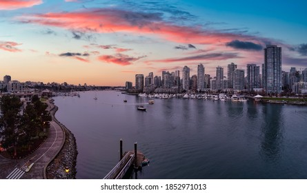 False Creek, Vancouver, British Columbia, Canada. Aerial Panoramic View of a Modern Downtown City View. Dramatic Colorful Sunset Sky.