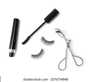 False eyelashes, mascara and curler on white background