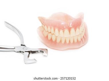 False teeth and pliers