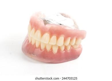false teeth prosthetic isolated on white background