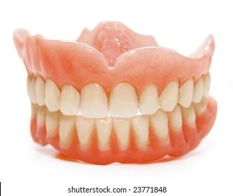 False teeth prosthetic on isolated white background