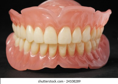 False teeth prosthetic on isolated  black background