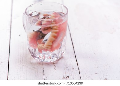 False teeth are in the water.