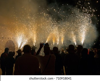Falset, Tarragona, Catalonia, Spain - August, 18, 2017. Correfoc, typical catalan celebration in which devils armed with fireworks dance through the streets.