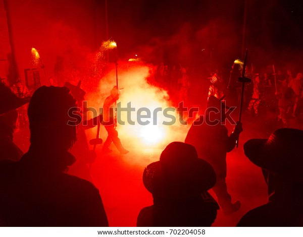Falset, Tarragona, Catalonia, Spain - August, 18, 2017. Correfoc (fire-runs), typical catalan celebration in which devils armed with fireworks dance through the streets.