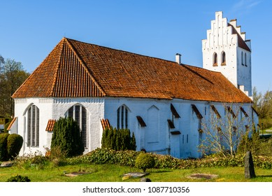 Falsterbo, Sweden - April 28, 2018: Travel documentary of everyday life and place. The church with part of the churchyard on a warm and sunny spring day.