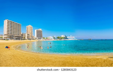 FAMAGUSTA, CYPRUS, AUGUST 29, 2017: People are enjoying a sunny day on a beach in front of Varosia district of Famagusta, Cyprus