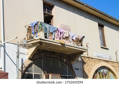 FAMAGUSTA / CYPRUS-09.18.2016.Openwork wrought-iron balcony, hung with drying linen .